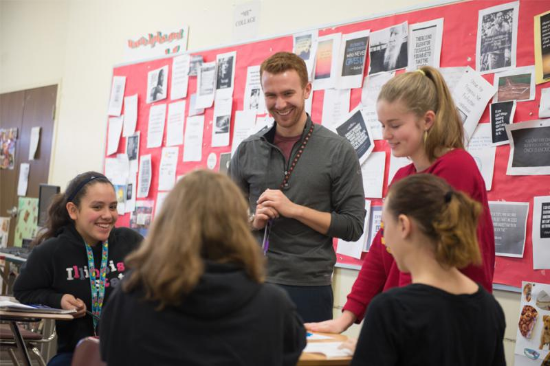 Illinois State University alum Blake Slutz '15 works with his students at LaSalle-Peru High School.