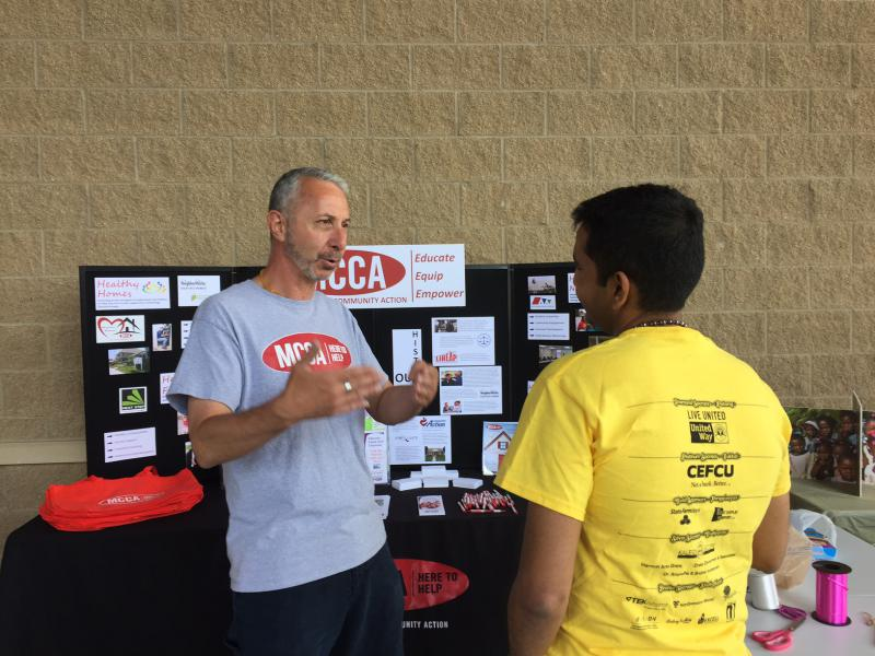Matt Drat from MCCA, one of the non-profits to benefit from the event, talks with a visitor to Kite Fest.