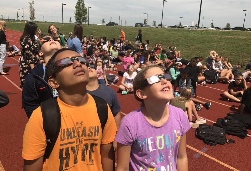 Students at Evans Junior High School look at the eclipse on Monday, Aug. 21, 2017.