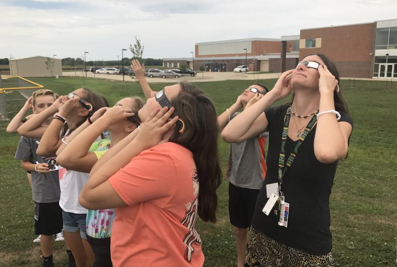Students and teachers at Evans Junior High School look at the eclipse on Monday, Aug. 21, 2017.