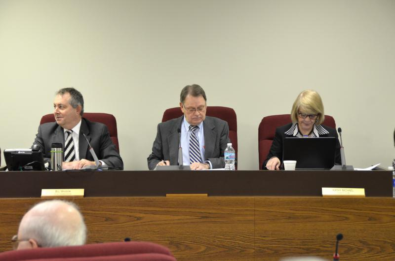From left, McLean County Administrator Bill Wasson, Board Chair John McIntyre, and Clerk Kathy Michael.