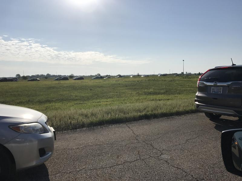 Motorists dropping off hazardous waste at the Rivian Auto Plant on Saturday were diverted around the old Mitsibishi test track while they waited in line.