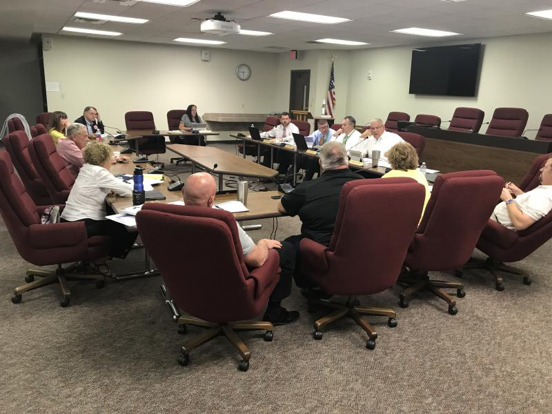 McLean County Board Finance Committee members discussed job cuts, early retirement incentives, and other measures for more than an hour and a half Monday afternoon.