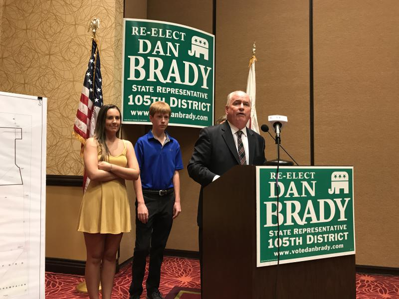 Surrounded by his family including daughter Danielle, left, son Tommy, center, and wife Terri, obscured by Dan, state Rep. Dan Brady announced he is running for re-election.