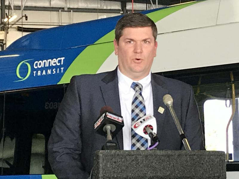 Connect Transit's Isaac Thorne spoke during a grant award ceremony for electric buses earlier this week.
