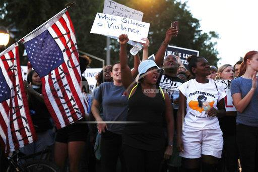 Demonstrators in St. Louis on Saturday protest the acquittal of a white former police officer in the shooting death of 24-year-old Anthony Lamar Smith. The verdict rekindled tensions between police and the minority community.