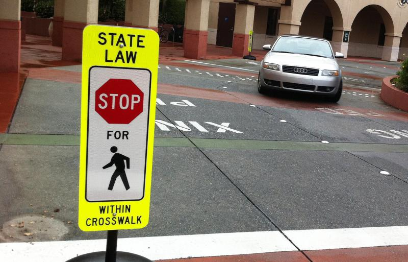 "Here's how the ""Stop for Pedestrians in Crosswalk"" signs look in other communities."