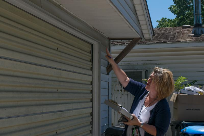 Bloomington housing inspector Gayle Price on the job this summer.