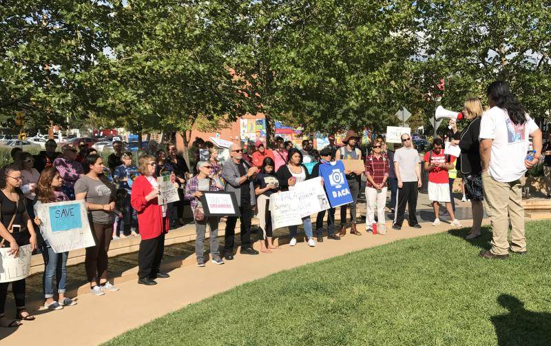 Around 100 people attended a #DefendDACA rally Tuesday, Sept. 5, 2017, in Uptown Normal.