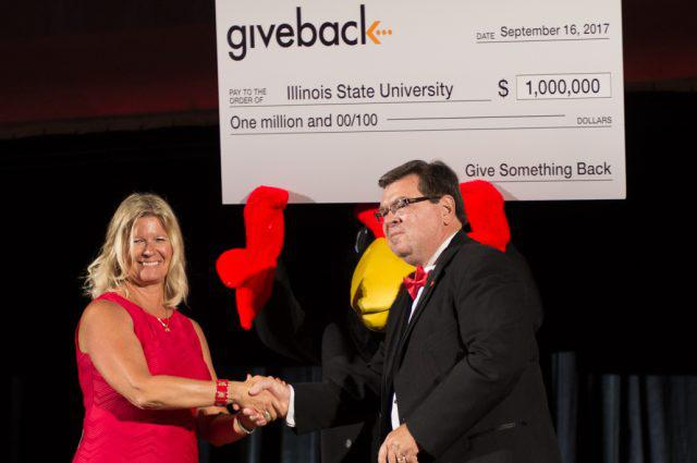ISU alum and daughter of Give Something Back founder Corrie Nichols, left, with President Larry Dietz.