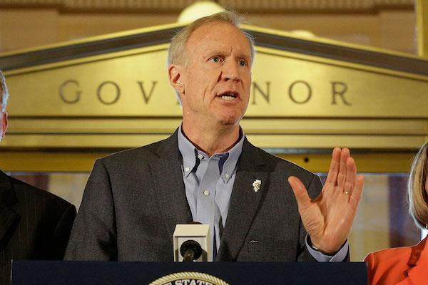 Bruce Rauner at a podium