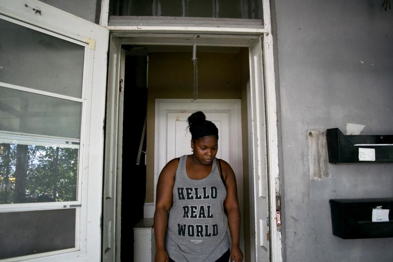 Moesha Tyner in her rundown Center Street property in Bloomington. The front door doesn't lock.