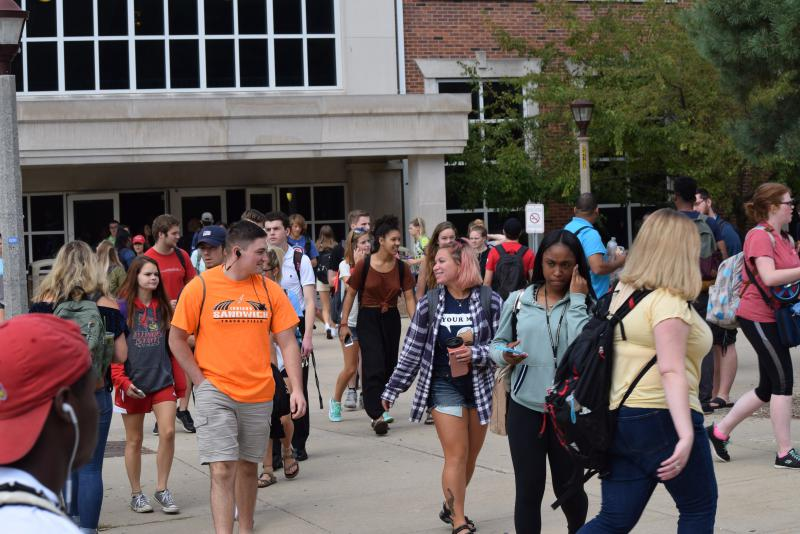 ISU students walk through Schroeder Plaza near the Quad in August 2017.