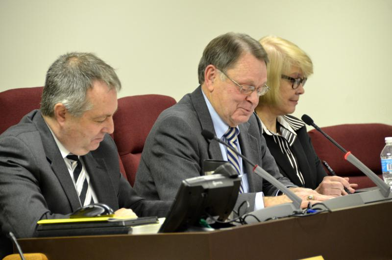 McLean County Board chair John McIntyre, center, flanked by Administrator Bill Wasson and Clerk Kathy Michael at a board meeting.