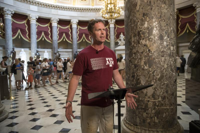 Rep. Rodney Davis, R-Taylorville, still wearing his baseball unifirm, describes for reporters on Capitol Hill in Washington, Wednesday, June 14, 2017, the scene during a shooting at a congressional baseball game in Alexandria, Va.