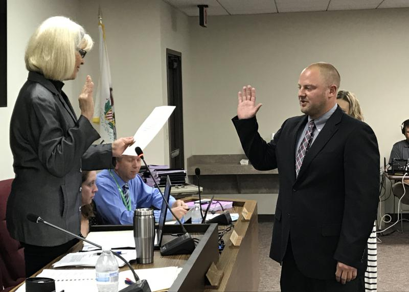 Ryan Scritchlow is sworn in during the McLean County Board meeting Tuesday, Sept. 19, 2017, in Bloomington.