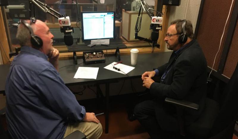 GLT's Jon Norton (left) interviews Wayne Messmer.