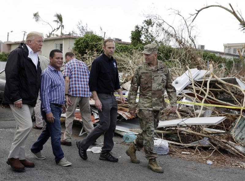 "President Trump tours damage from Hurricane Maria in Guaynabo, Puerto Rico.  A group of business executives recently described his management style as ""chaotic."""