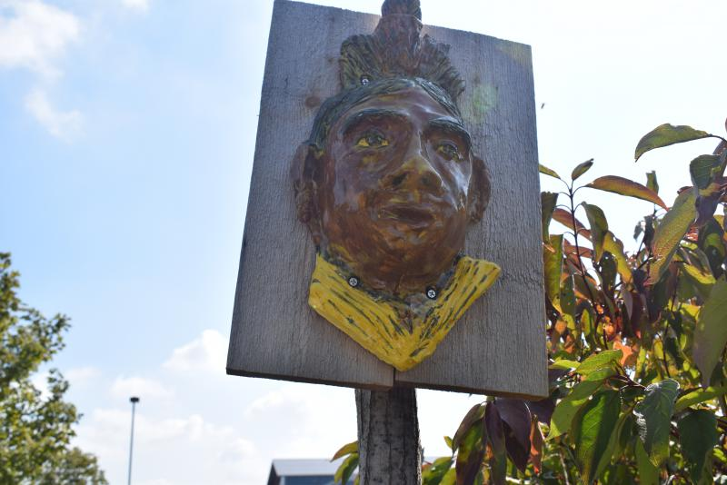 The face of an Osage Indian near the entrance of the Heartland Community College Gardens.