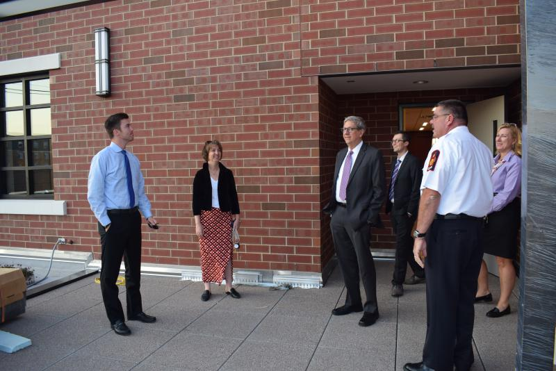 Normal council members tour the rooftop overlooking Main Street at the new Normal Fire Department headquarters station.
