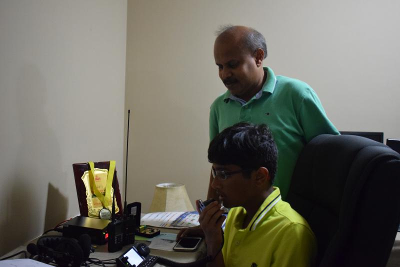 Dhruv Rebba and his father, Hari, a State Farm analyst and avid ham radio operator.