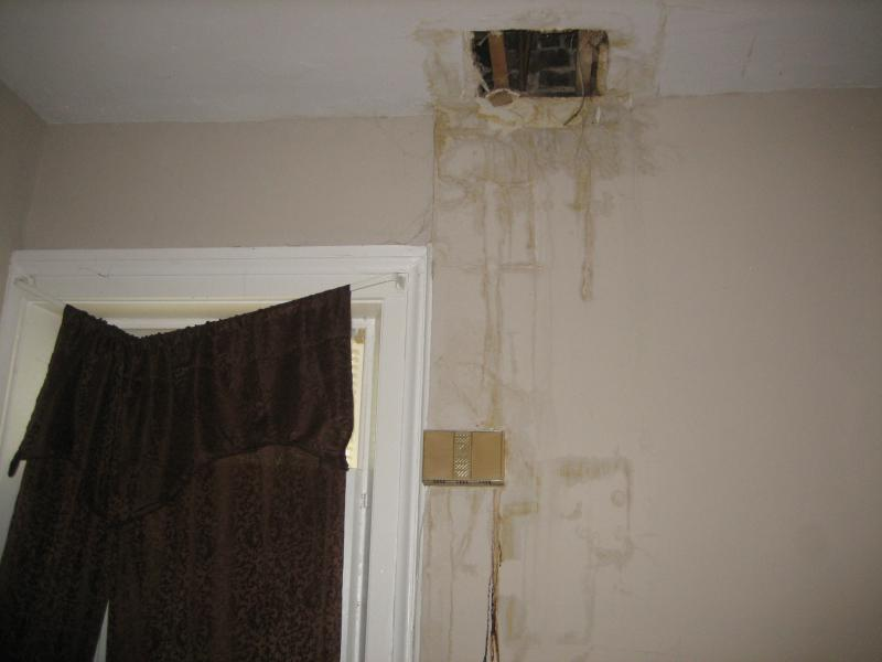 Water damage to the ceiling and wall in the first floor unit of a two-family rental property at 705 S. Center St., Bloomington.