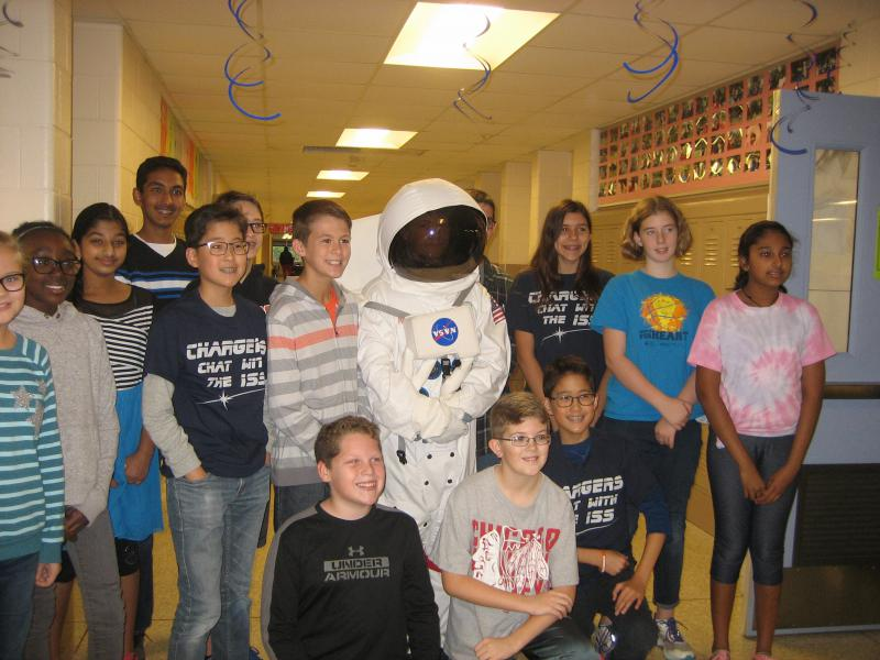 Students at Chiddix Junior High School prepare to ask questions of an astronaut aboard the International Space Station. One student came dressed for a space walk.