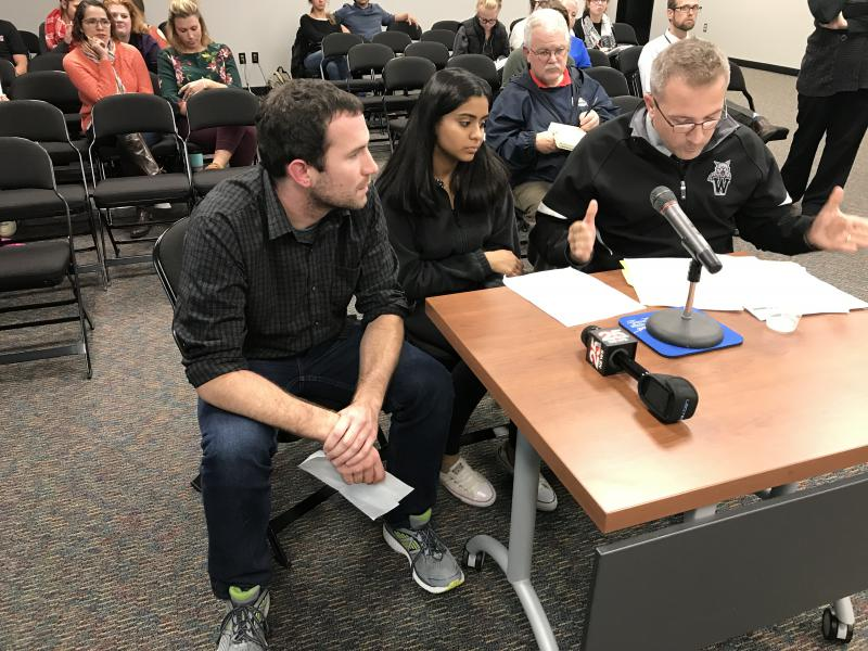 From left: NCHS teacher Patrick Lawler, NCHS student Aditi Sharma, and Normal West teacher John Bierbaum address the Unit 5 School Board on treatment of immigrant students and faculty.
