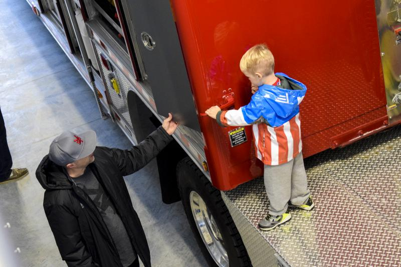 A Child Exploring A Fire Truck