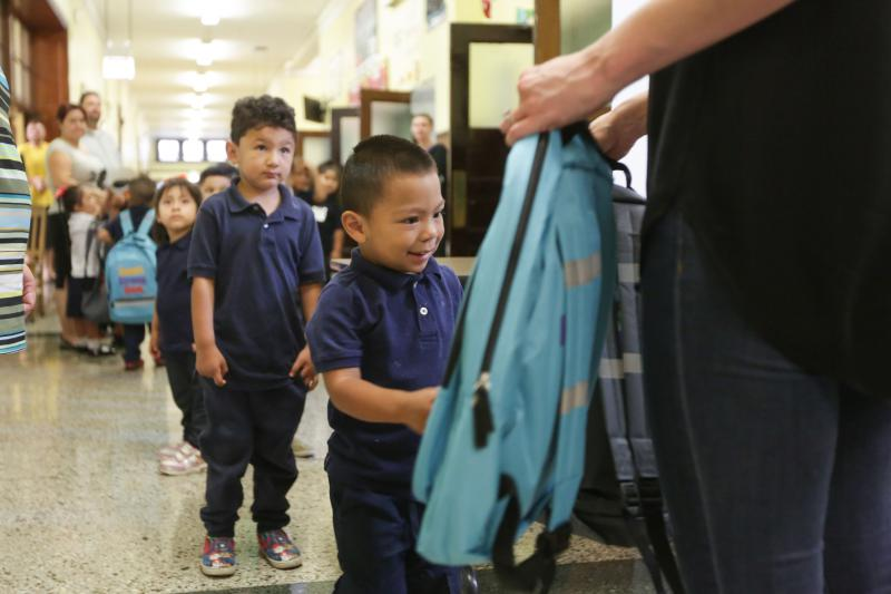 Kids pick up school supplies at Douglas Taylor School in Chicago, Sept. 7, 2016.