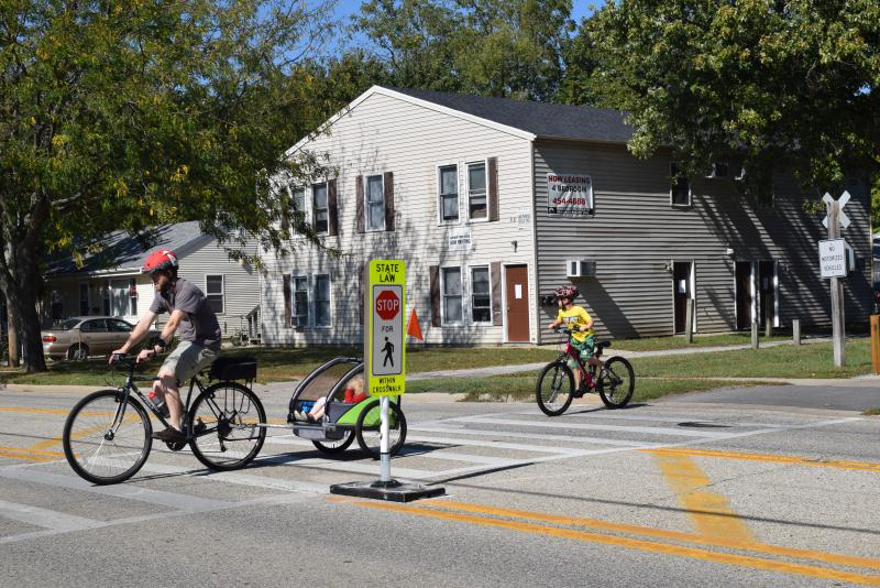 Bicyclists cross the Constitution Trail on Willow Street on Monday, Oct. 9, 2017, in Normal.