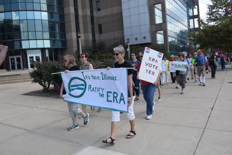 Supporters of the Equal Rights Amedment march across Illinois State University's campus Sept. 16. The Illinois Family Institute is attempting to lobby constituents against the ERA through pre-recorded phone calls to B-N households.