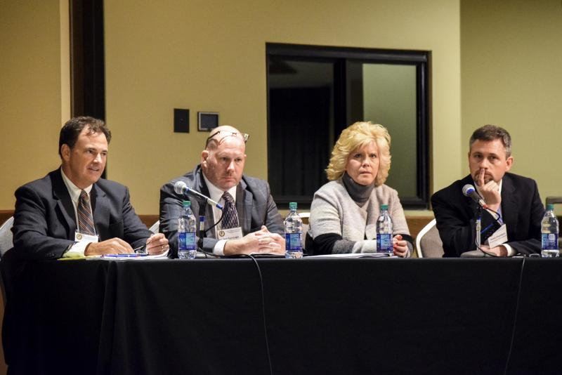 From left, McLean County Judge Casey Costigan, Sheriff Jon Sandage, Coroner Kathy Davis and State's Attorney Jason Chambers served on a panel during a McLean County Bar Association-U.S. attorney's office co-sponsored conference on the opioid epidemic.