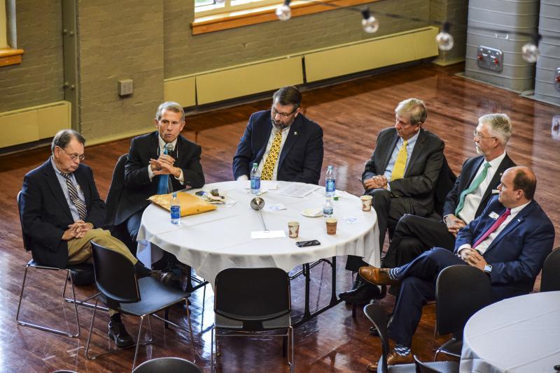 From left, McLean County Board Chairman John McIntyre, Bloomington Mayor Tari Renner, Danvers Mayor Tom Caisley, Normal Mayor Chris Koos, IWU President Eric Jensen, and Charlie Moore from the McLean County Chamber of Commerce.
