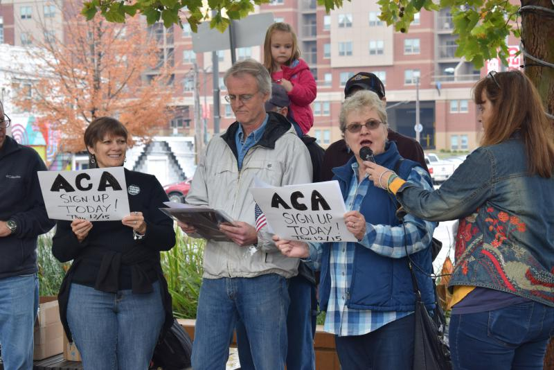 Voices of Reason and Indivisible IL-18 host an event in Uptown Normal earlier this month to promote enrollment in Affordable Care Act healthcare plans.