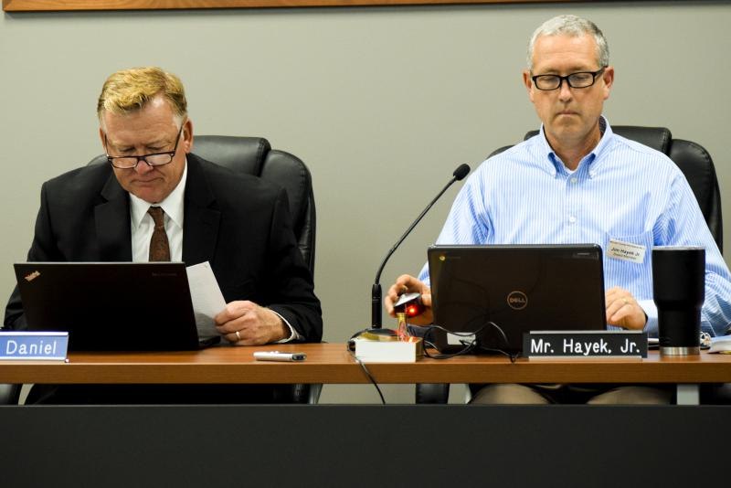 Unit 5 Superintendent Mark Daniel, left, with School Board President Jim Hayek during a recent meeting in Normal.