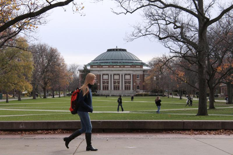 University of Illinois students walk across the Main Quad on campus in Urbana.
