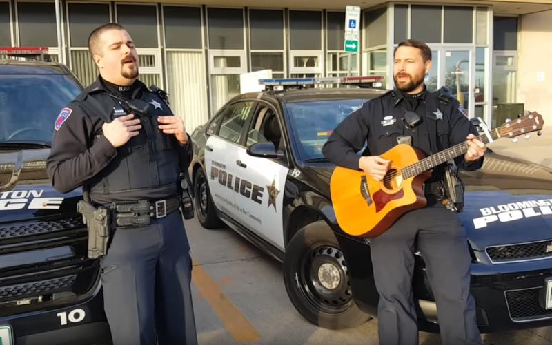 Officers Logan Fosdick and Paul Jones perform outside Bloomington City Hall.