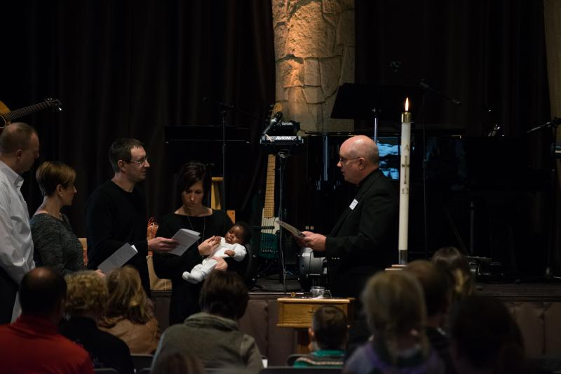 Pastor Lanny Westphal of St. John's Lutheran baptizes a newborn at a recent Sunday service.