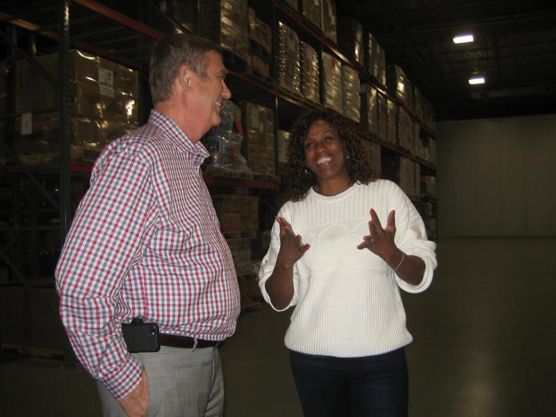 Olympic medalist Jackie Joyner-Kersee talks with David Kieser of the Midwest Food Bank in Normal. The food bank will begin shipping food items to the youth center Joyner-Kersee founded in East St. Louis.