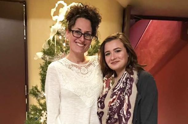 "Tracy McCoy of Normal and her daughter, Bella, at the Normal Theater. They go to see ""White Christmas"" there every year."