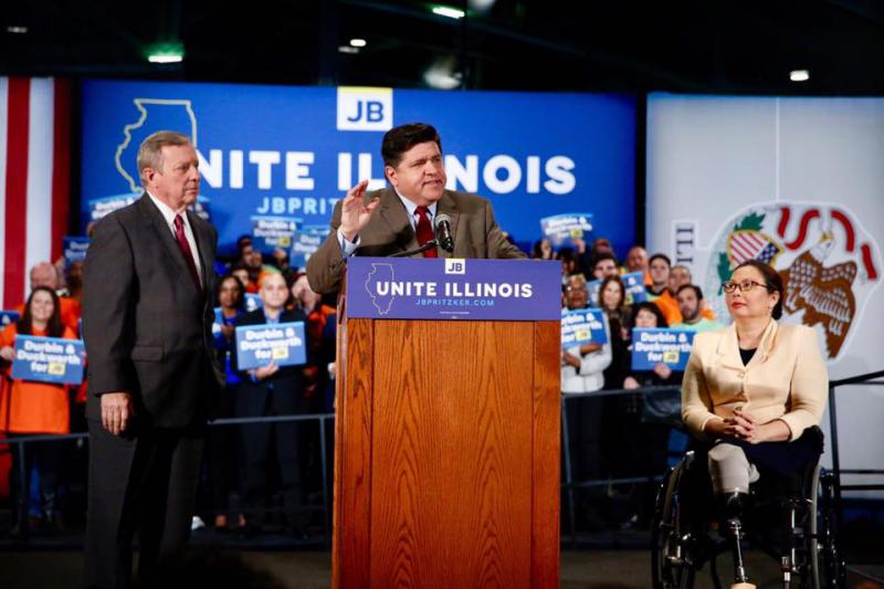 Democratic candidate for governor JB Pritzker with Sens. Dick Durbin and Tammy Duckworth on Friday, Dec. 8, 2017, in Chicago.