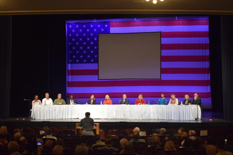 City council members at a dais in the Center for the Performing Arts.