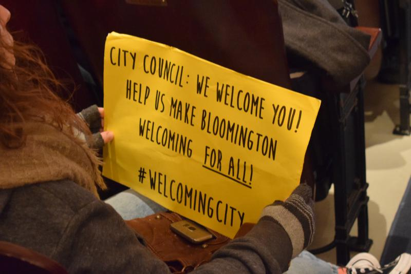 One of the signs held by Welcoming City supporters Monday, Dec. 18, 2017, at the BCPA.