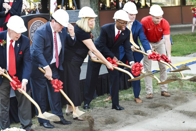 Illinois State University officials and student leaders move some dirt at the Bone Student Center groundbreaking ceremony Friday, Sept. 15, 2017.