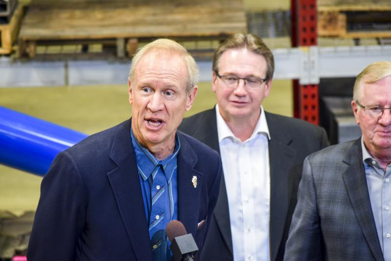 Gov. Bruce Rauner with Shaun Semple, center, and Gavin Semple from Brandt Industries on Friday, Dec. 1, 2017.
