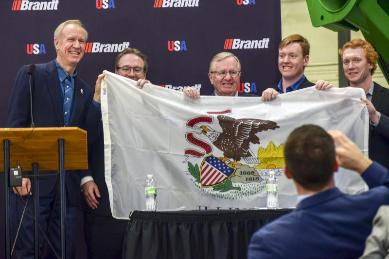 Gov. Bruce Rauner presenting the Semple family with an Illinois flag on Friday, Dec. 1, 2017.