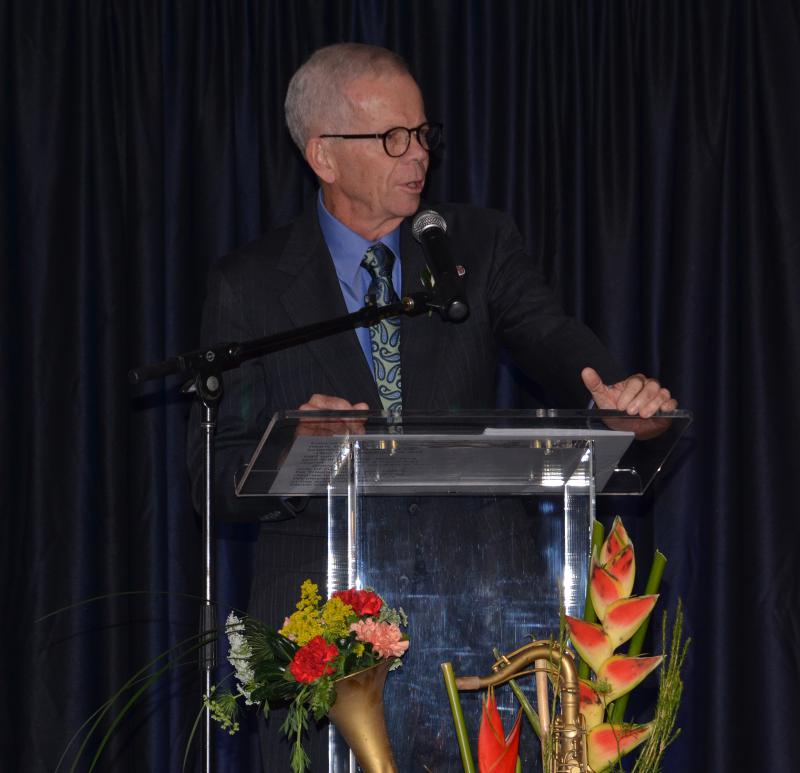 Don Munson addresses a packed audience at GLT's Radio Faces celebration in 2014.