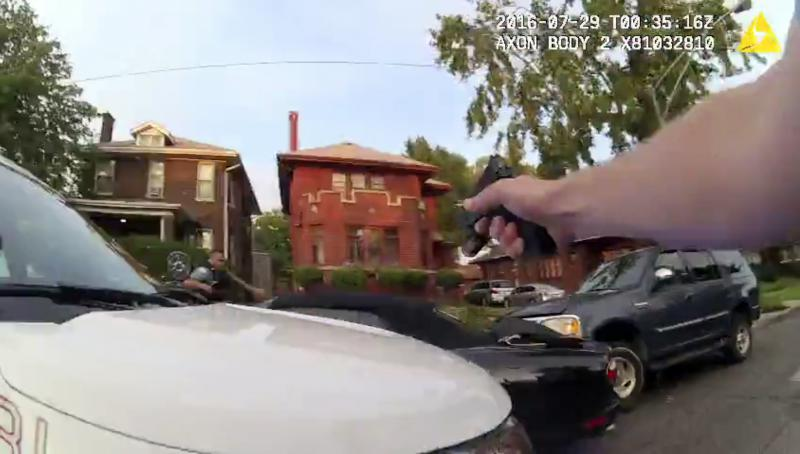 In this July 28, 2016, file image made from a body camera video provided by the Independent Police Review Authority, Chicago police officers fire into a stolen car driven by Paul O'Neal, killing him, in Chicago.