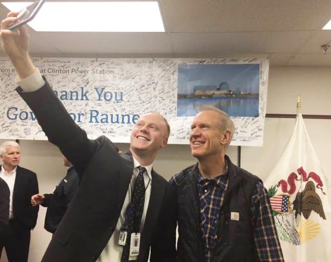 Gov. Bruce Rauner takes a photo during his visit to Clinton on Tuesday, Dec. 12, 2017.
